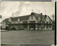 "View from across intersection of two-story, Tudor-style, corner ""Sears"" building"