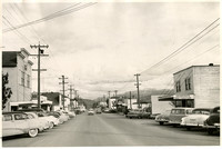 Fairhaven Avenue, Burlington, Washington with mid-20th century-era cars one- and two-story commercial buildings lining street