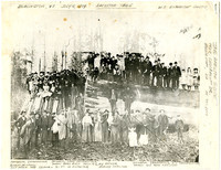 Photocopy of photograph of large group of men, women, children posing on and in front of enormous, felled 21' diameter cedar tree and stump, with hand-written captions identifying several people