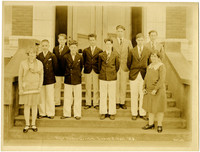 Uniformed boys choir on steps of Lowell School with teacher Grace Sullivan, 1928