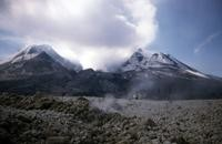 The crater, seen from the pyroclastic flow, with steam rising in foreground.