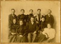 Family of ten posed for formal portrait