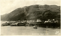 Seaside village with cannery wharf and several vessels in water at Kodiak, Alaska