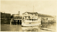 "View from Whatcom Creek waterway of passenger ferry ""Carlisle"" landing at Citizen's Dock, Bellingham, WA"