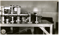 A piece of cannery processing equipment stands in lab