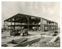 Large, metal-framed ferry terminal under construction in Fairhaven (Bellingham), Washington