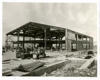 Large, metal-framed ferry terminal under construction in Fairhaven (Bellingham), Washington