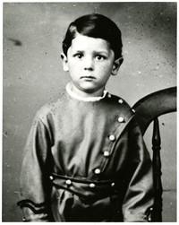 Young Jimmy Pickett in children's soldier's costume in studio portrait