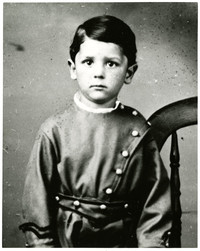 Young Jimmy Pickett in children's soldier's costume in studio portrait