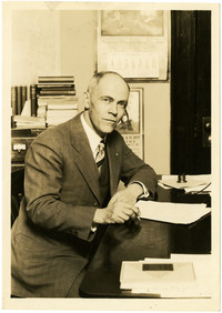 Mr. Howell of Fairhaven High School seated at desk
