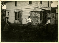 Fast picture with new camera - two women swing rope for man in center to jumprope