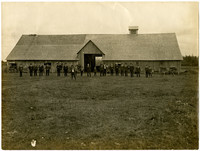 Milky Way Farm, Sumas: Large barn at with a number of men lined up in front