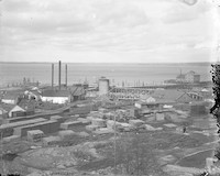 Lumber yard in Fairhaven, WA on Bellingham Bay with multiple buildings and assorted stacks of lumber