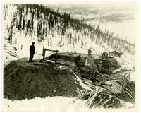Unidentified location in a snowy mountain landscape (possibly mining operation)