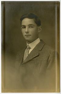 Studio portrait of adolescent boy in suit