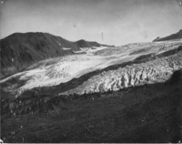 A color-tinted photo taken at the end of a glacier, most likely on Mount Baker