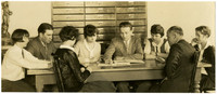 Fairhaven High School students sit around a table with a teacher and principal E.S. Howell