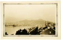 Vista of city and lake of Lucerne, Switzerland, from watch tower on old city wall