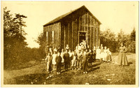 Group of schoolchildren and teacher pose outside small, one-room Sehome schoolhouse, Whatcom County, WA