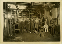 Six machinists and supervisor stand in machine shop