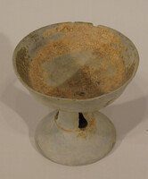 Bowl on high foot with three teardrop form slots in stem