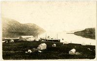 Bayside cannery facility with steamer vessel moored at dock, Matan Bay, Alaska