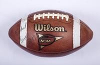 "Football: Wilson NCAA football (front side, signed ""Michael Koenen #19""), undated"
