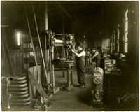 Knute Evertz operates drill press in his molding works