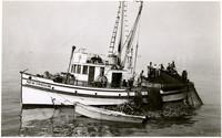 "Multiple fishermen haul nets onto deck of fishing vessel ""New Oregon"""