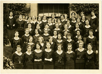 """Large group of female Fairhaven High School students pose on steps, """"Girls 'F' Club"""