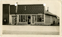 Checkered-patterned barbershop and candy/cigar shop storefront