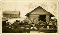 King Cove, Alaska, 1st store - warehouse with bagged and boxed goods piled outside