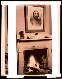 Fireplace at the Pickett House with portrait of General George A. Pickett hung above mantle