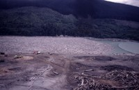 Machinery removing logs from immense jam at east end of Swift Reservoir.