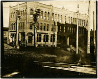 """Three-story """"Sunset Block"""" building at northwest corner of Holly and Elk (State) Streets, Bellingham, WA"""