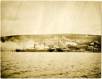 Steam ship, four-masted sailing ship moored to docks at E.K. Wood Lumber Company on Bellingham Bay, WA