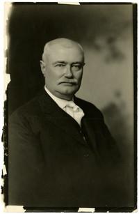 Studio portrait of A.W. Deming