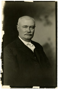 Studio portrait of A.W. Deming