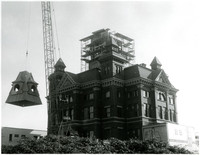 Bellingham City Hall with new central tower under construction behind scaffolding, and crane hoisting new tower roof