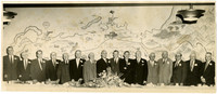16 former Presidents of the Bellingham Chamber of Commerce pose behind banquet table at the Bellingham Hotal