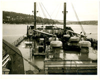 Taken from the deck of a ship or barge, heading toward an unidentified bridge