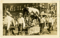 Kids in pirate costume carry a litter with young girl in Tulip Festival Parade, Bellingham, WA, 1929