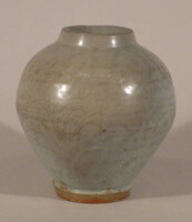 Ovoid vase with incised whirls under pale grey glaze