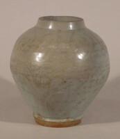 Ovoid vase with incised whirls under pale grey glaze