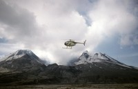 The crater, seen from the pyroclastic flow, with airborne helicopter in foreground.