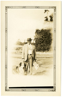 Man poses with collie