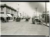 Street scene on Fairhaven Avenue, Burlington, Washington, with early-model cars and one- and two-story commercial buildings