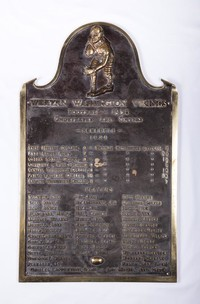Football Plaque: Bronze plaque commemorating Western Washington Vikings' undefeated and untied season, 1938