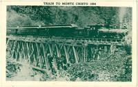 Steam locomotive pulls several passenger cars over trestle through forest en route to Monte Cristo, 1894