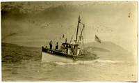 """Peter Hitco, Excusion Inlet, Alaska - Motorized fishing vessel """"Vis IV"""" with American flag"""